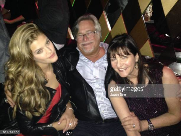 Model Nina Agdal Miami Heat owner Micky Arison and his wife Madeleine Arison pose circa March 2014 in Miami Florida