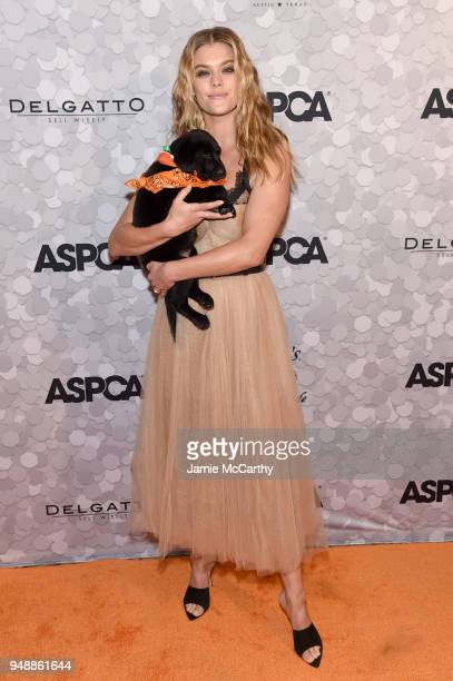 Model Nina Agdal poses with a puppy during the 21st Annual Bergh Ball hosted by the ASPCA at The Plaza Hotel on April 19 2018 in New York City