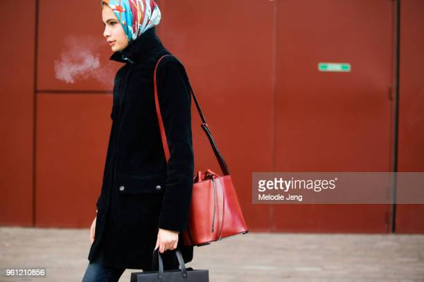 Model Nina Marker wears a printed headscarf black jacket and red leather bag during London Fashion Week Spring/Summer 2018 on September 17 2017 in...