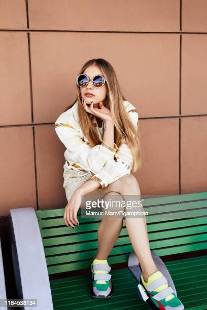 Model Noa Zijlmans is photographed for Madame Figaro on December 2 2017 in Miami Florida Jacket tshirt and skirt sunglasses sneakers PUBLISHED IMAGE...