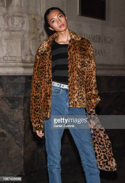 Model Noah Los is seen wearing a leopard coat black striped sweater and blue jeans and leopard bag outside the Alexander Wang Fall 2019 show on...