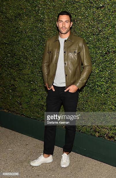 Model Noah Mills attends Claiborne Swanson Frank's Young Hollywood book launch hosted by Michael Kors at Private Residence on October 2 2014 in...