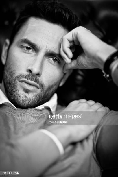 Model Noah Mills is photographed for Sport Style on September 24 2012 in Milan Italy