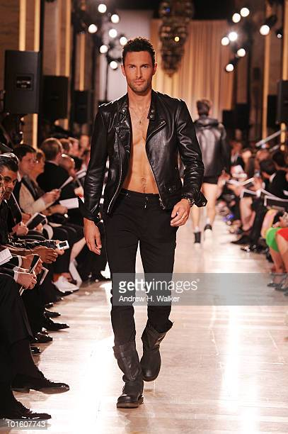 Model Noah Mills walks the runway during the 2010 amfAR New York Inspiration Gala at The New York Public Library on June 3 2010 in New York New York