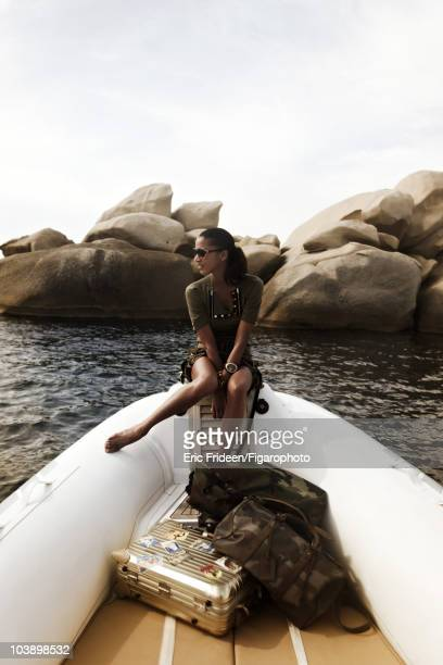 Model Noemi Lenoir at a James Bond inspired fashion session for Madame Figaro Magazine in 2009 in Corsica, France. Clothing by Gucci, sunglasses by...
