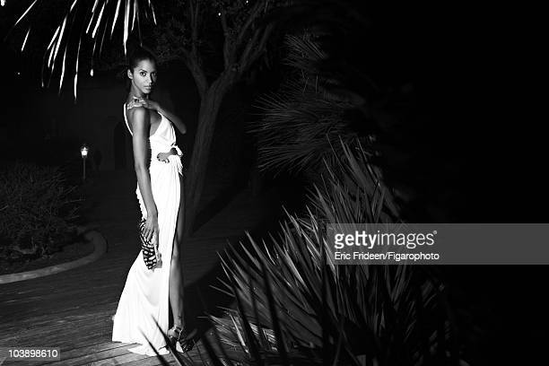 Model Noemi Lenoir at a James Bond inspired fashion session for Madame Figaro Magazine in 2009 in Corsica France Gown by Roberto Cavalli ring by...