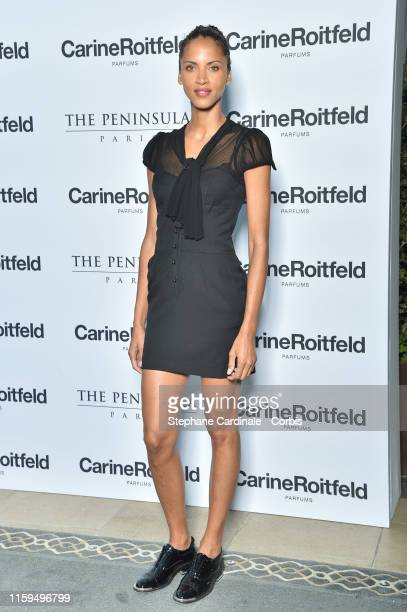 Model Noemie Lenoir attends the Carine Roitfeld Parfums 7 lovers Cocktail At The Peninsula Hotel In Paris on July 01 2019 in Paris France