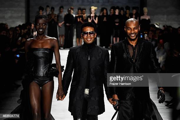Model Nykhor Paul designer David Tlale and model Tyson Beckford walk the runway at the David Tlale fashion show during MercedesBenz Fashion Week Fall...