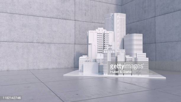 model of a city with skyscraper - image manipulation stock pictures, royalty-free photos & images