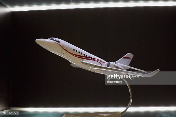 A model of a company jet is displayed in the Dassault Aviation SA Falcon Jet parts distribution center at Teterboro Airport in Teterboro New Jersey...