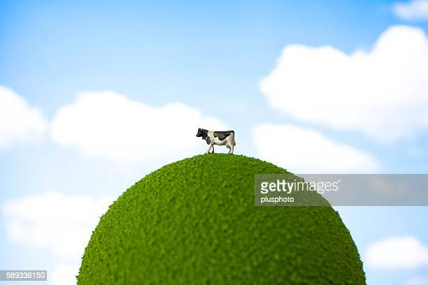 Model of a Cow Standing on a Grassy Planet