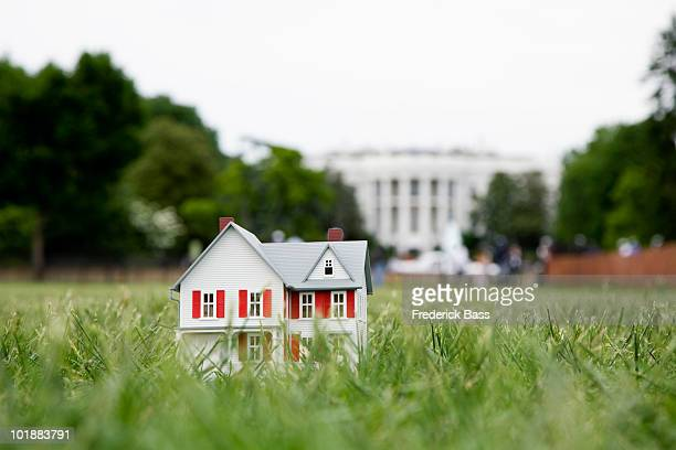 A model of a domestic house in front of the White House, Washington DC, USA