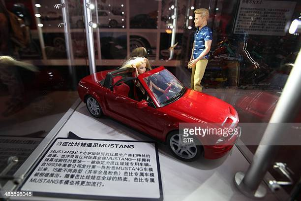 A model of a Ford Mustang car is seen on display at the 50 years celebration ceremony of Ford Mustang in Beijing on April 19 ahead of the 'Auto China...