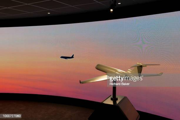 A model of a generic aircraft and the images from a video presentation in the exhibition chalet of United Technologies at the Farnborough Airshow on...