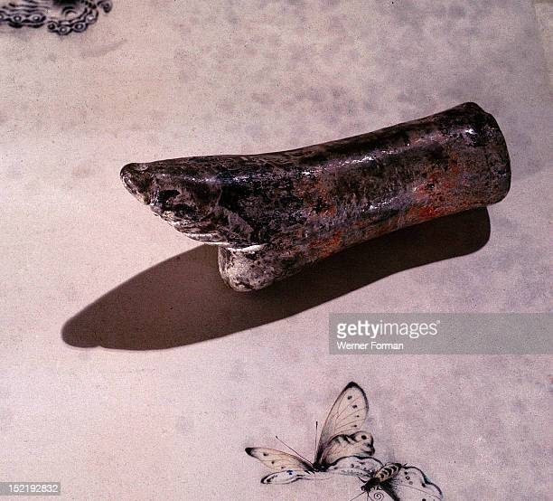 A model of a lily foot possibly used as a teaching model for the process of binding girls feet with the aim of creating the tiny feet which were...