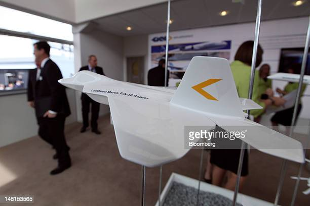 A model of a Lockheed Martin F/A22 Raptor sits on display inside GKN Plc's stand on the third day of the Farnborough International Air Show in...