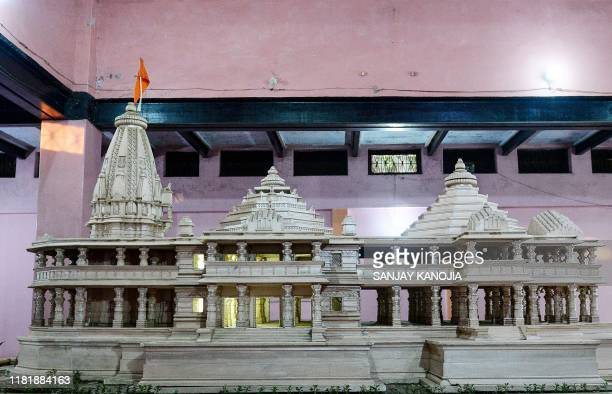 A model of a proposed Ram Hindu temple is displayed at Karsevakpuram campus in Ayodhya on November 12 2019 Huge slabs of pink Rajasthan stone carved...