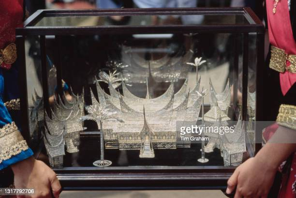 Model of a Sumatran village, cast in silver, presented to British Royals Charles, Prince of Wales and Diana, Princess of Wales during their visit to...