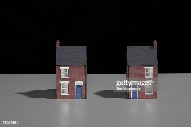 model of a terraced brick house split into two. - dollhouse stock pictures, royalty-free photos & images