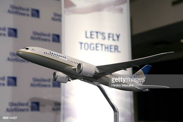 A model of a United Airlines jet with Cntinental Airlines logo is displayed at a press conference May 3 2010 in New York City United and Continental...