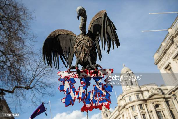 A model of a vulture is carried through central London during a demonstration in support of the NHS on March 4 2017 in London England Thousands march...