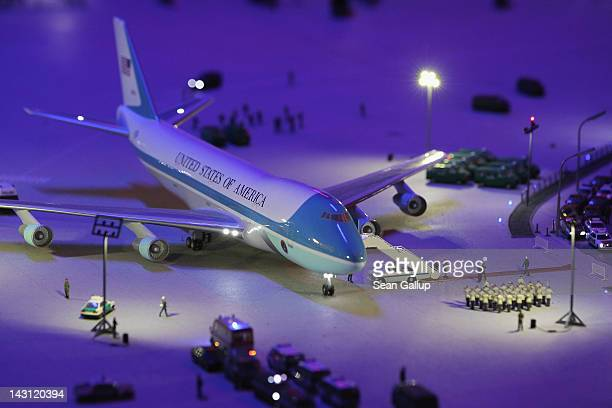 A model of Air Force One complete with red carpet and a marching band glows at the airport of the LOXX miniature train landscape at the Alexa...
