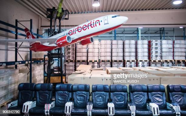 A model of an Air Berlin aircraft is displayd next to plane seats on January 18 2018 during a presentation of items of former airline Air Berlin The...