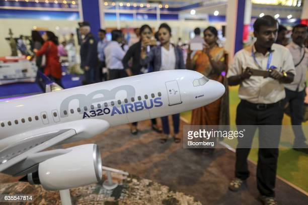 A model of an Airbus SE A320neo aircraft stands at company's booth during the Aero India air show at Air Force Station Yelahanka in Bengaluru India...