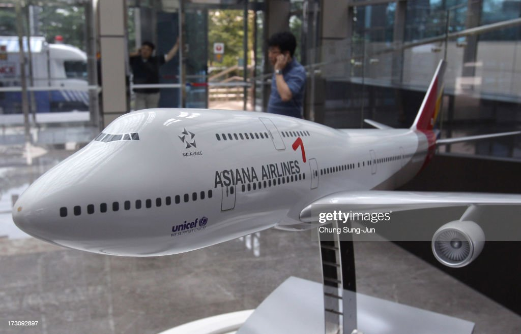 A model of an Asiana Airlines aircraft is seen at their headquarters on July 7, 2013 in Seoul, South Korea. Two people are dead and more than 180 injured after an Asiana Airlines Boeing 777 aircraft coming from Seoul, South Korea crash-landed at San Francisco International Airport on July 6, 2013.