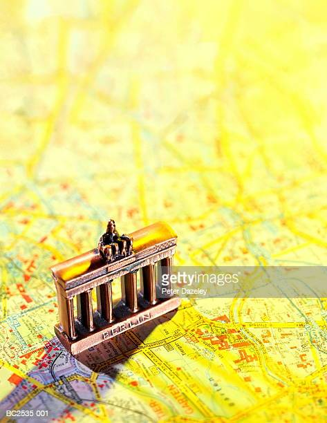 Model of Brandenburg Gate, Berlin, Germany, on city street map