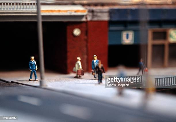 model of commuters in front of train station - human representation stock pictures, royalty-free photos & images