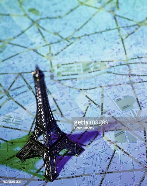 Model of Eiffel Tower, Paris, France, on city street map
