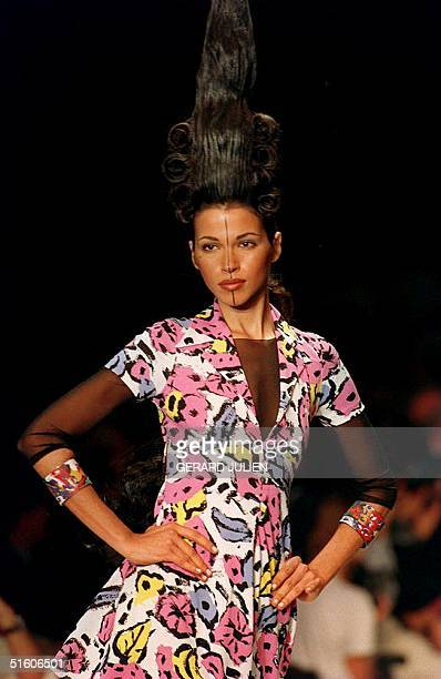 A model of German designer Karl Lagerfield presents a jersey flower print dress on a black skindress 11 October 1993 during Lagerfield's SpringSummer...