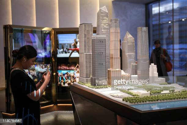 A model of Hudson Yards is displayed in a showroom for residences during the grand opening of phase one of the Hudson Yards development on the West...