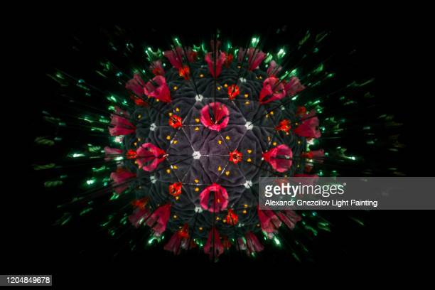 model of human coronavirus particle created with kaleidoscope - coronavirus stock-fotos und bilder