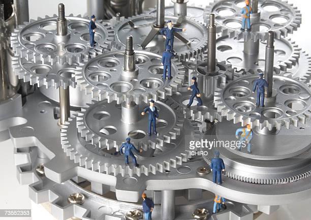 Model of man in cogs