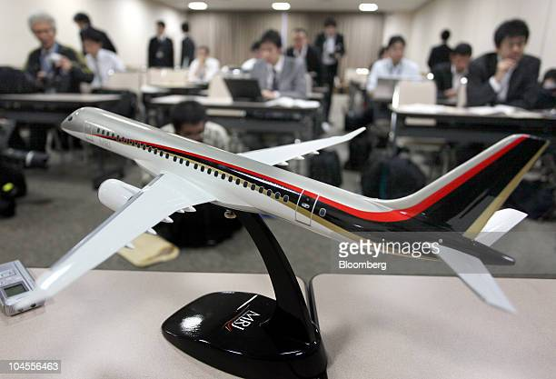 A model of Mitsubishi Aircraft Corp's next generation airplane Mitsubishi Regional Jet is displayed during the metal cutting ceremony for the...