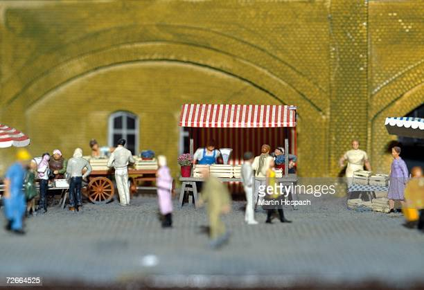 Model of people shopping at market stalls in town square