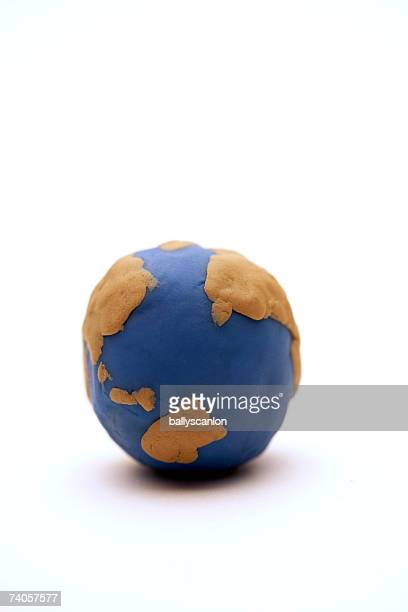 Model of planet earth made on clay on white background