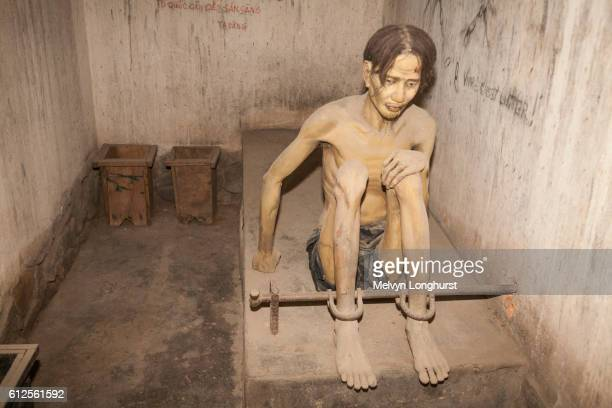 model of prisoner in a tiger cage, war remnants museum, ho chi minh city, (saigon), vietnam - torture stock pictures, royalty-free photos & images