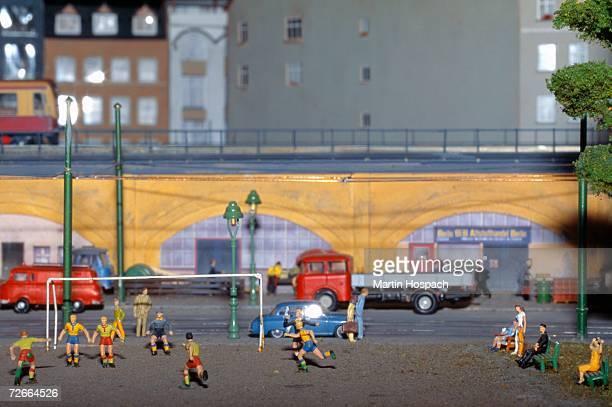 Model of soccer match near railway track