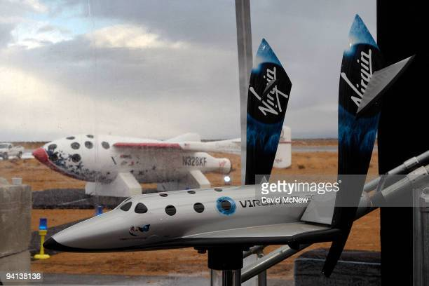 Model of SpaceShipTwo is seen with the original SpaceShipOne visible outside as Virgin Galactic unveils its new SpaceShipTwo spacecraft at the Mojave...