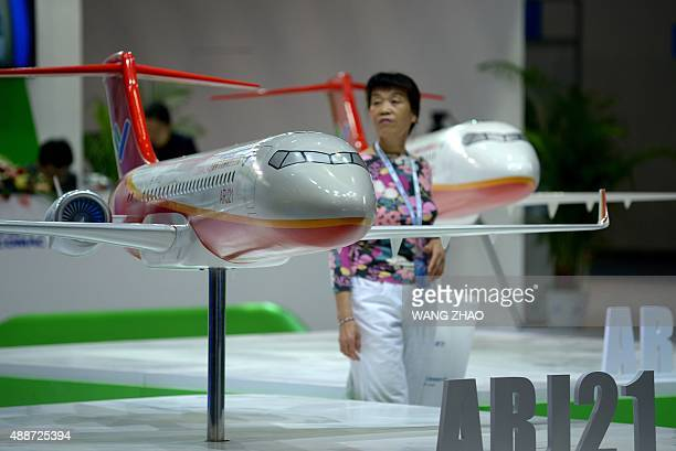 A model of the ARJ21 designed by Commercial Aircraft Corporation of China is displayed at the Beijing International Aviation Expo in Beijing on...