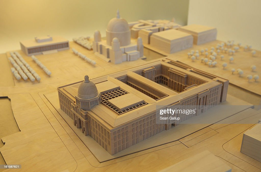 A model of the Berliner Schloss city palace stands on display at the Schlossbauhuette studio where a team of sculptors is creating decorative elements for the new Berliner Schloss on February 12, 2013 in Berlin, Germany. The Berliner Schloss was the residence of the Prussian Kaiser and was among the major architectural landmarks of Berlin until it was heavily damaged by Allied bombing in 1945. The communist authorities of East Berlin demolished the building in the 1950s, and today's Berlin government is pursuing an ambitious project to rebuild the palace according to a design by Italian architect Franco Stella, which will recreate the facade of the building but with a modern interior at a cost of approximately EUR 590 million. The Humboldt Forum, the foundation leading the project, has given the Schlossbauhuette sculptors the formidable task of recreating the hundreds of architectural elements that decorated the facade, and though some original pieces were saved, more often the sculptors have only old black and white photos as reference.