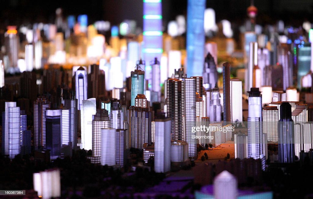 A model of the city of Shanghai is displayed at the Shanghai Urban Planning Exhibition Center in Shanghai, China, on Tuesday, Jan. 29, 2013. China's economic growth accelerated for the first time in two years as government efforts to revive demand drove a rebound in industrial output, retail sales and the housing market. Photographer: Tomohiro Ohsumi/Bloomberg via Getty Images