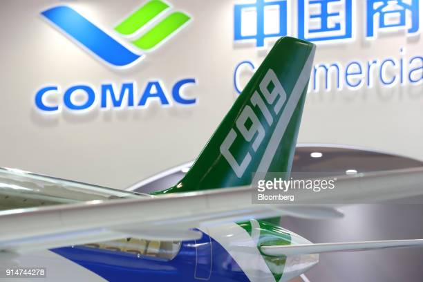 A model of the Commercial Aircraft Corp of China Ltd C919 aircraft sits on display at the Singapore Airshow held at the Changi Exhibition Centre in...