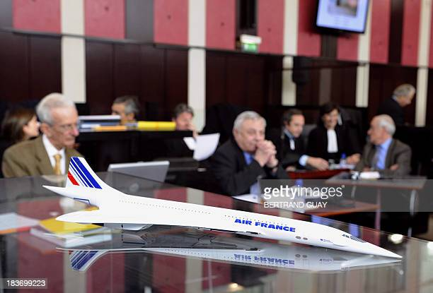 A model of the Concorde is seen as former technical controller of civilian aviation Claude Frantzen and French former heads of the Concorde division...
