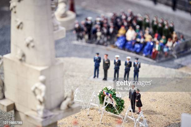 Model of the Dam Square with figurines of King Willem-Alexander and Queen Maxima of the Netherlands are pictured in the miniature park Madurodam in...