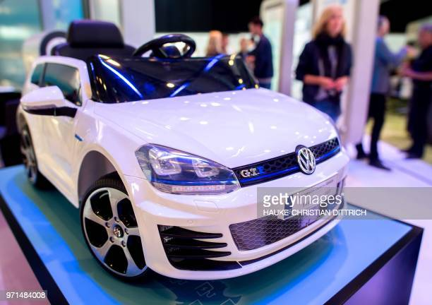 A model of the hybrid vehicle Volkswagen Golf GTE is on display at the Volkswagen stand at the Cebit technology fair in Hanover on June 11 2018 The...