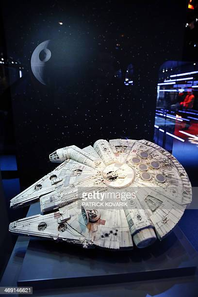 """Model of the Millenium Falcon starship from the Star Wars film series is displayed during the presentation of the exhibition """"Star Wars Identities""""..."""